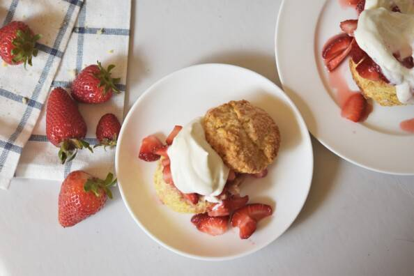 overhead of strawberry shortcake on a white plate