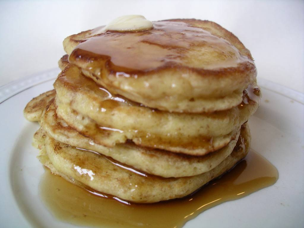 a stack os buttery syrupy kefir pancakes