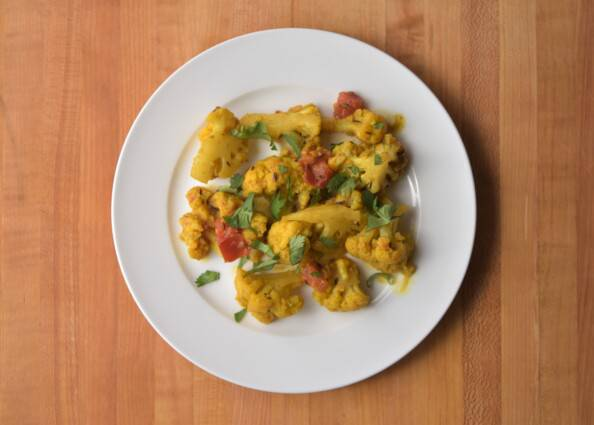 Indian spiced cauliflower overhead on a white plate