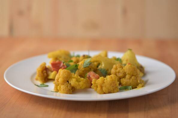 curried cauliflower on a white plate
