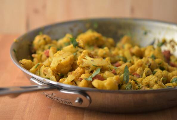 cauliflower cooked in curry spices in a skillet
