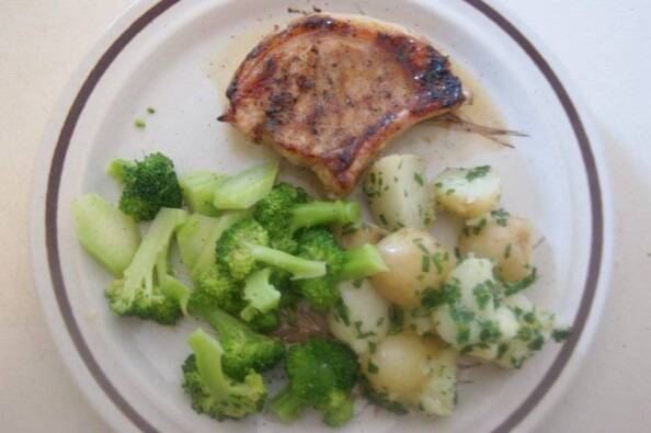 Brown-Sugar Grilled Pork Chops, new potatoes with chive-parsley butter, steamed broccoli