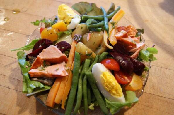 a composed salad of salmon, boiled egg, steamed vegetables