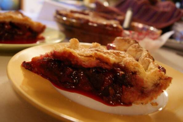 slice of apple plum blackberry pie
