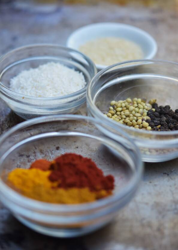 assortment of Indian spices in small glass bowls