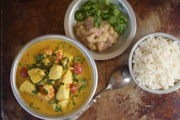 overhead of coconut curry with basmati rice and banana chutney