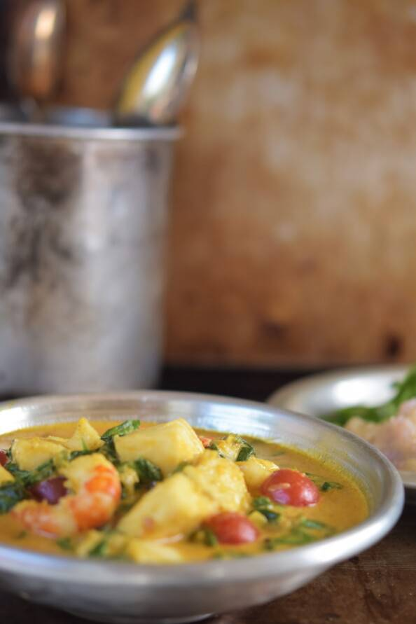 south Indian coconut seafood curry in a silver bowl