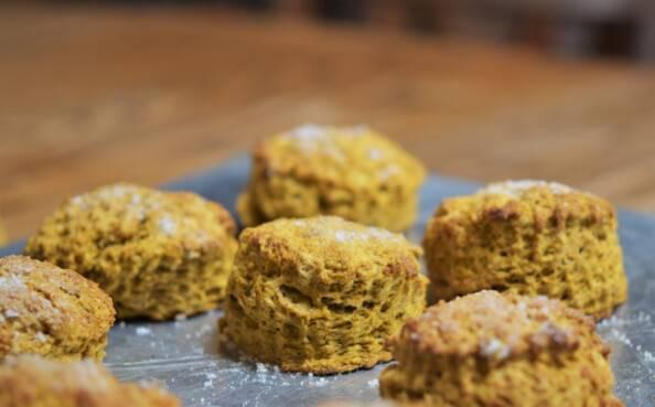 pumpkin spice scones on a silver baking tray